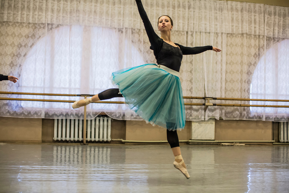 DONETSK, UKRAINE - FEBRUARY 1, 2015: Ballerina Tatiyana Ladiskaya leaps in the air during a practice for the Donetsk National Academic Opera and Ballet Theatre in Donetsk, Ukraine. The opera company kicked off a new season in October, despite a separatist insurgency in Eastern Ukraine that has killed more than 5000 people. CREDIT: Brendan Hoffman for The New York Times