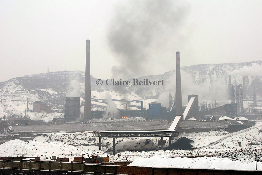 Black smoke rise from a coal power plant. Shanxi Province is China's largest coal supplier: 500 millions of tonnes per year. This Province is also the most polluted of China. Polluting enterprises are mainly in industrial sectors such as coal, power, metallurgy, chemistry, coking and building materials.