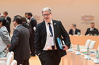 07 JUL 2017, HAMBURG/GERMANY:<br /> Lars-Hendrik Roeller, Abteilungsleiter Wirtschafts- und Finanzabteilung im Bundeskanzleramt, 1. Arbeitssitzung, G20 Gipfel, Messe<br /> IMAGE: 20170707-01-012<br /> KEYWORDS: G20 Summit, Deutschland, Lars-Hendrik R&ouml;ller