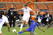 20 October 2014: Yvrose Gervil (HAI) (right) tackles the ball from Tobin Heath (USA) (center). The United States Women's National Team played the Haiti Women's National Team at RFK Memorial Stadium in Washington, DC in a 2014 CONCACAF Women's Championship Group A game, which serves as a qualifying tournament for the 2015 FIFA Women's World Cup in Canada. The U.S. won the game 6-0.