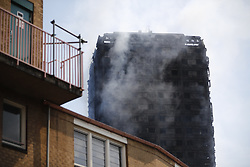 © Licensed to London News Pictures. 14/06/2017. London, UK. Firefighters try to control the Grenfell Tower fire in west London on 14 June 2017. Photo credit: Tolga Akmen/LNP
