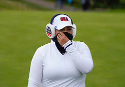 Auchterarder, Scotland, UK. 14 September 2019. Saturday afternoon Fourballs matches  at 2019 Solheim Cup on Centenary Course at Gleneagles. Pictured;  Lizette Salas of Team USA with ear muffs and face scarf to protect against cold wind.  Iain Masterton/Alamy Live News