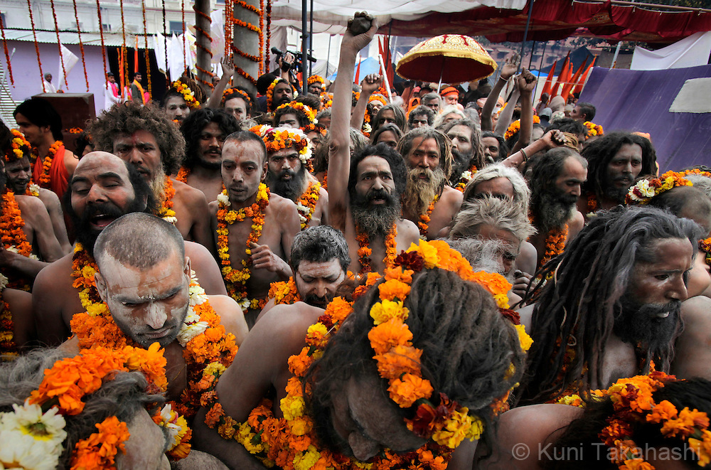 Sadhus (holy men) march on the street in Haridwar, India on Feb 2010 during Kumb Mela, largest Hindu gathering in the world. Hindus believe that bathing in the Ganges during the festival cleanses them of sin. Photo by Kuni Takahashi.