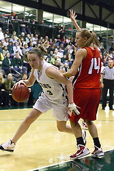 29 January 2011: Olivia Lett works past Diana Jacklin during an NCAA Womens basketball game between the Carthage Reds and the Illinois Wesleyan Titans at Shirk Center in Bloomington Illinois.