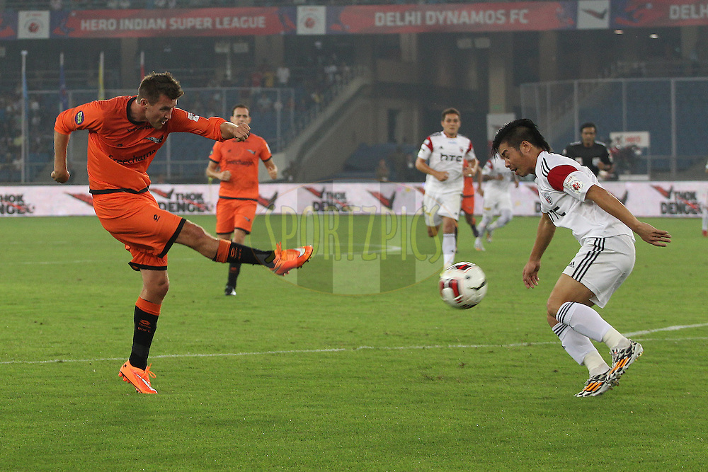 Mads Junker of Delhi Dynamos FC shoots during match 16 of the Hero Indian Super League between The Delhi Dynamos FC and NorthEast United FC held at the Jawaharlal Nehru Stadium, Delhi, India on the 29th October 2014.<br /> <br /> Photo by:  Ron Gaunt/ ISL/ SPORTZPICS
