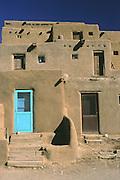 bright aqua door in tan adobe building, contrast, Taos Pueblo