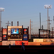 The Bridgeport Harbor Power Station provides a back drop to the ballpark in the late evening light during the Bridgeport Bluefish V Southern Maryland Blue Crabs, Atlantic League, Minor League ballgame at Harbor Yard Ballpark, Bridgeport, Connecticut, USA. Photo Tim Clayton