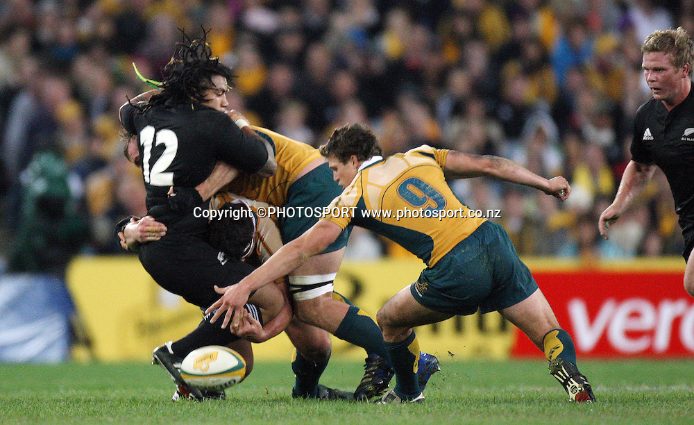 Ma'a Nonu is crunched by the Wallabies defense and drops the ball as Wallabies halfback Luke Burgess looks to pick up.<br />Philips Tri Nations, Australia v All Blacks, ANZ Stadium, Homebush, Sydney, Saturday 26 July 2008. The Wallabies defeated the All Blacks 34-19. Photo: Andrew Cornaga/PHOTOSPORT