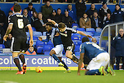Brentford defender James Tarkowski attempts to tackle Birmingham City midfielder Jacques Maghoma during the Sky Bet Championship match between Birmingham City and Brentford at St Andrews, Birmingham, England on 2 January 2016. Photo by Alan Franklin.