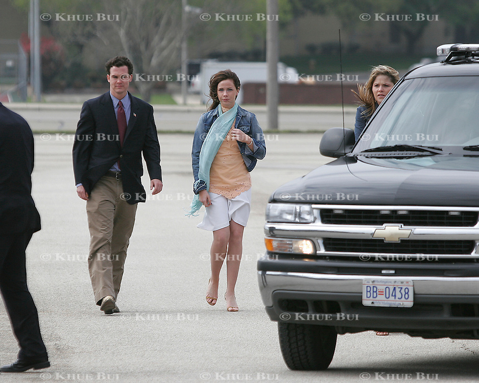 Daughters Barbara and Jenna Bush load into motorcade vehicles for Easter services Sunday, March 27, 2005, at Ft. Hood in Killeen, TX.  Person at left is identified only as a friend of the family by the White House...Photo by Khue Bui