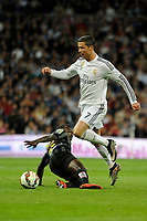 Real Madrid´s Cristiano Ronaldo and Malaga´s Arthur Boka during 2014-15 La Liga match between Real Madrid and Malaga at Santiago Bernabeu stadium in Madrid, Spain. April 18, 2015. (ALTERPHOTOS/Luis Fernandez)