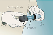 A vector illustration of a battery brush showing the two brushes