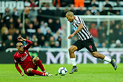 Jose Salomon Rondon (#9) of Newcastle United takes the ball away from Fabinho (#3) of Liverpool who slips during the Premier League match between Newcastle United and Liverpool at St. James's Park, Newcastle, England on 4 May 2019.