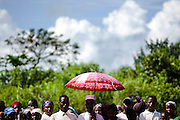 People wait outside  the Garga Sarali integrated health center in the town of Garga Sarali, near Bertoua, Cameroon, on the occasion of the visit of UNICEF Goodwill Ambassador Mia Farrow on Tuesday September 15, 2009..