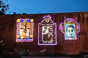 Projections of people who died in the past year are projected on the wall of the San Juan de Dios cemetery during the Dia de Muertos festival in San Miguel de Allende, Mexico. The multi-day festival is to remember friends and family members who have died using calaveras, aztec marigolds, alfeniques, papel picado and the favorite foods and beverages of the departed.