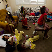 Adopted children from three families watch television at Sandy and Lyle Reed's home.