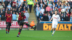 SWANSEA, WALES - Sunday, March 11, 2012: Manchester City's Mario Balotelli shoots from the half-way line as the crowd's jeering begins to get to him during the Premiership match against Swansea City at the Liberty Stadium. (Pic by David Rawcliffe/Propaganda)