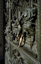 THEMENBILD - Die Lombardei ist eine norditalienische Region mit einer Fläche von 23.863 km und ca.9,8 Mio. Einwohnern. Sie ist in zwölf Provinzen aufgeteilt und liegt zwischen Lago Maggiore, Po und Gardasee. Bilder aufgenommen am 21. August 2013, im Bild durch Beruehrung abgegriffenes Detail bronzenes Portal mit Szenen aus dem Leben Marias, Kirchenmotive, Bildhauer Lodovico Pogliaghi, Westfassade Kathedrale Mailaender Dom oder Duomo di Santa Maria Nascente // THEMES PICTURE - Lombardy is a northern Italian region with an area of 23,863 km and a population of 9,8 Mio. It is divided twelve provinces and is situated between Lake Maggiore, Lake Garda and Po. Pictured on 2013/08/21. EXPA Pictures © 2013, PhotoCredit: EXPA/ Eibner/ Michael Weber<br /> <br /> ***** ATTENTION - OUT OF GER *****