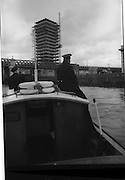 08/03/1964<br /> 03/08/1964<br /> 08 March 1964<br /> Views at the port of Dublin. View of Liberty Hall from a boat on the Liffey.