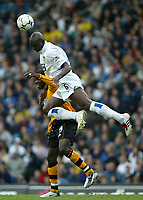 Photo. Andrew Unwin<br /> Leeds United v Blackburn Rovers, Barclaycard Premier league, Elland Road, Leeds 04/10/2003.<br /> Leeds' Zoumana Camara (r) outjumps Blackburn's Dwight Yorks (l).