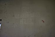 Roma 7 Febbraio  2014<br /> Il Centro di identificazione ed espulsione (CIE), per immigrati di Ponte Galeria a Roma. In una stanza su un muro  una svastica e la scritta: Grazie Hitler<br /> Center for Identification and Expulsion (CIE) for immigrants from Ponte Galeria in Rome. In a room on a wall a swastika and the words: Thank Hitler