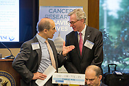 Dr. Stan Gerson, left, and Dr. Daniel Hayes, right, talk during a joint May Hill Day breakfast at Rayburn House Office building in Washington, DC, on Thursday, May 4, 2017.  The group was preparing to meet with members of congress to lobby for cancer research funding (Alan Lessig/)