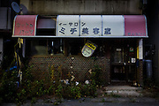 Tomioka, Fukushima prefecture, November 18 2013 - Abandonned hair salon near Tomioka train station in the evacuation zone. The clock is stuck at 2:46pm, the time when the earthquake occured on March 11 2011.