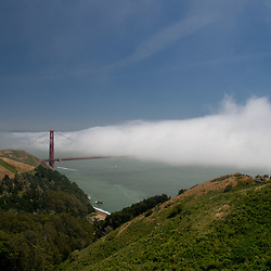 Fog rolls in over the Golden Gate  Bridge and San Francisco, Marin Headlands, Marin County, California, US