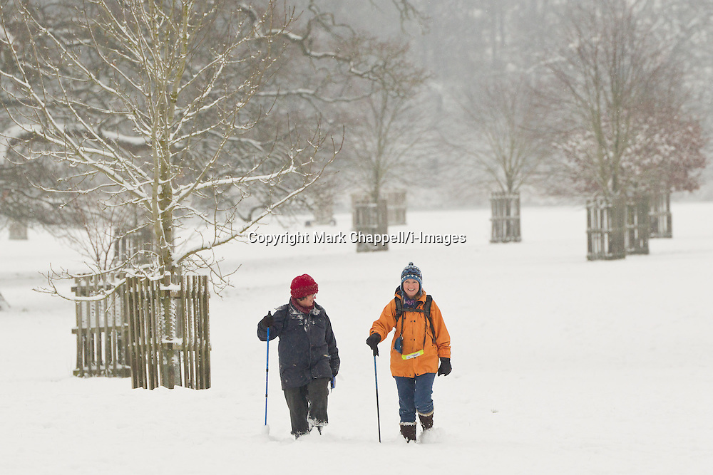 Walkers dress for cold weather in Corsham Park following overnight snow in north Wiltshire. January 18 2013.  Corsham, UK..Photo by: Mark Chappell/i-Images