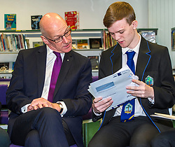 Pictured: Mr Swinney checks Alistair Hampton's results.<br /> <br /> <br /> Education Secretary  John Swinney visited Firrhill School today and met students and parents as the results wer available for opening.<br /> <br /> <br /> Ger Harley | EEm 7 August 2018