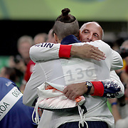 Gymnastics - Olympics: Day 9   Max Whitlock #138 of Great Britain is congratulated by Men's Head National Coach Eddie Van Hoof after performing his routine in the Men's Pommel Horse Final which won him the gold medal at the Rio Olympic Arena on August 14, 2016 in Rio de Janeiro, Brazil. (Photo by Tim Clayton/Corbis via Getty Images)