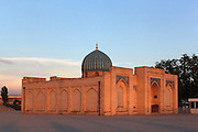 """Low angle view of Tellya Sheikh Mosque from behind, founded 16th century, restored 19th century, Khast Imam Square, Tashkent, Uzbekistan, pictured on July 4, 2010, in the afternoon. Tashkent's main Friday mosque holds the Osman Koran, claimed to be the world's oldest, in its library. Tashkent, 2000 year old capital city of Uzbekistan, a Silk Road city whose name means """"Stone Fortress"""", is now very modern due to a disastrous earthquake in 1966, after which it was greatly rebuilt. However, some of the old buildings still stand in the glittering modern city. Picture by Manuel Cohen."""