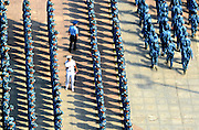 WUHAN, CHINA - SEPTEMBER 14: (CHINA OUT) <br /> <br /> A lesson in obedience: Spectacular images show thousands of Chinese students stand to attention in harsh military training that marks the start of their university education<br /> <br /> <br /> Photographs of compulsory military training at a Chinese university has recently emerged across Chinese media.<br /> Around 9,000 new students were part of the military training at Wuhan University of Technology in central China, reported People's Daily Online.<br /> The images, taken on September 14, depicted dense but neat rows of students standing to attention while their drill sergeants walked between them.<br /> The drills were said to be part of the mandatory military training at the university. After their training, the students would go on to study for their degrees. <br /> During training, students are expected to march and stand up straight for hours regardless of the weather.<br /> Students receive regular inspections and there's generally no entertainment or social life.<br /> However, they do sometimes get to play team building games and are expected to learn military songs, stories and chants.<br /> Military training for students was introduced in China back in 1955. <br /> Although it's only been mandatory for all secondary school and university students since 2001, it has been 'trialed' across the country since 1985. <br /> <br /> Training lasts for around two weeks during the summer months although they have been up to a year in the past.<br /> Compulsory drills has divided Chinese citizens.<br /> ©Exclusivepix Media
