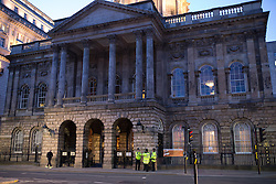 © Licensed to London News Pictures . 04/03/2015 . Liverpool , UK . Police stand guard outside Liverpool Town Hall as inside councillors debate cuts to the annual city budget and an increase in council tax . The 2015 City Council Budget Meeting for Liverpool . Photo credit : Joel Goodman/LNP