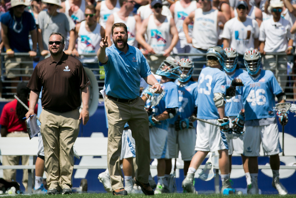 05/25/2014 - Baltimore, Md. - Tufts head coach Mike Daly yells to his players in Tufts' 12-9 win over Salisbury to win the NCAA Division III Men's Lacrosse National Championship game at M&T Bank Stadium on May 25, 2014. (Kelvin Ma/Tufts University)