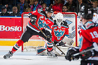 KELOWNA, CANADA - NOVEMBER 26: Devante Stephens #21 tries to block a shot that is saved by Michael Herringer #30 of the Kelowna Rockets against the Regina Pats on November 26, 2016 at Prospera Place in Kelowna, British Columbia, Canada.  (Photo by Marissa Baecker/Shoot the Breeze)  *** Local Caption ***