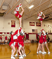 LHS Cheerleading squad lifts Katie Gorman and Gillian Gorse during their performance for the crowd at the boys varsity basketball game Tuesday evening.  (Karen Bobotas/for the Laconia Daily Sun)