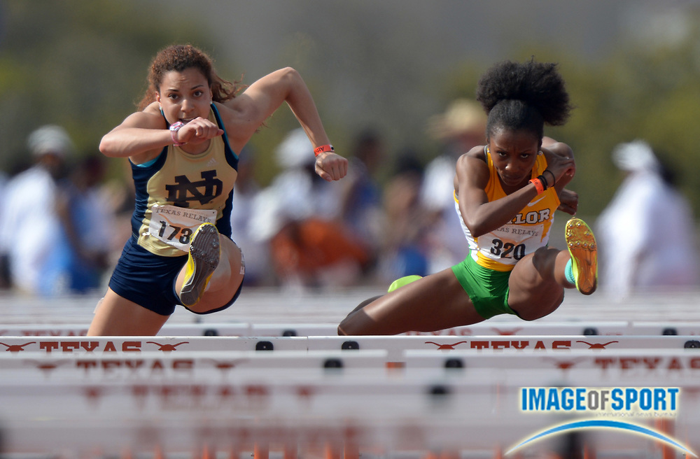 Mar 28, 2014; Austin, TX, USA; Jade Barber of Notre Dame (left) and Tiffani McReynolds of Baylor compete in a womens 100m hurdles heat in the 87th Clyde Littlefield Texas Relays at Mike A. Myers Stadium. Both runners were timed in 13.21.