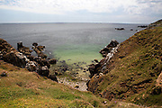 """View of the """"Wherry Hole"""" below the cliffs on the south, unsheltered side of the Great Saltee, the larger of the Saltee Islands, off the coast of Co. Wexford, Ireland."""