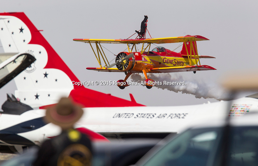 Wing walker Teresa Stokes performs with Gene Soucy, during Los Angeles County Air Show, in Lancaster, California on March 21, 2015. (Photo by Ringo Chiu/PHOTOFORMULA.com)