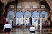 During the holy month of Ramadan, Indian Muslims are praying inside the Taj-ul-Masajid, one of Asia's largest mosques, in Bhopal, Madhya Pradesh, India.