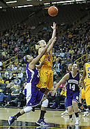December 30, 2011: Iowa Hawkeyes guard Kamille Wahlin (2) puts up a shot as Northwestern Wildcats guard Tailor Jones (34) defends during the NCAA women's basketball game between the Northwestern Wildcats and the Iowa Hawkeyes at Carver-Hawkeye Arena in Iowa City, Iowa on Wednesday, December 30, 2011.