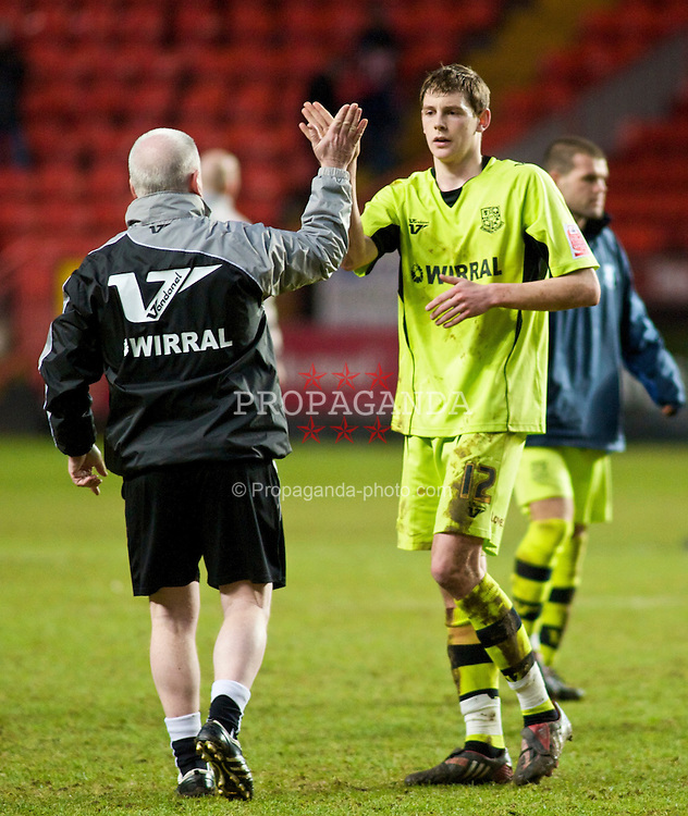 LONDON, ENGLAND - Saturday, January 30, 2010: Tranmere Rovers' Ash Taylor is congratulated by Manger Les Parry after a 1-1 result against Charlton Athletic during the Football League One match at the Valley. (Photo by Gareth Davies/Propaganda)