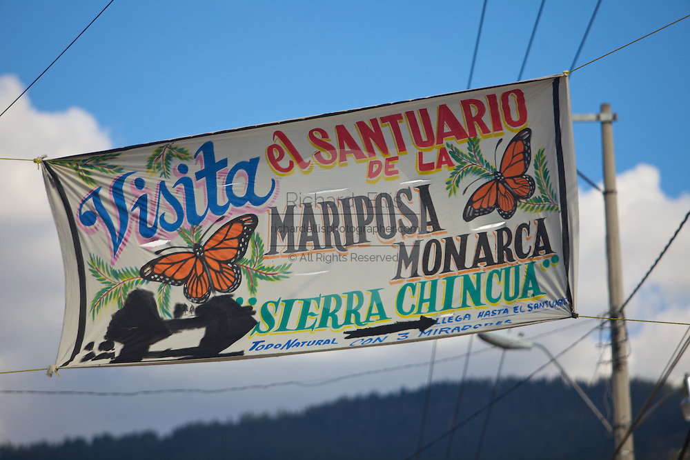 A sign in spanish marking the entry to the Monarch Butterfly Biosphere Reserve in Sierra Chincua central Mexico in Michoacan State. Each year hundreds of millions Monarch butterflies mass migrate from the U.S. and Canada to Oyamel fir forests in the volcanic highlands of central Mexico. North American monarchs are the only butterflies that make such a massive journey—up to 3,000 miles (4,828 kilometers).