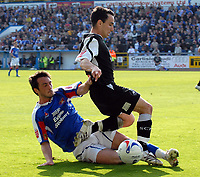 Carlisle's Paul Thirwell and Swansea's Lee Britton.