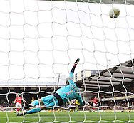 Picture by David Horn/Focus Images Ltd +44 7545 970036<br /> 14/09/2013<br /> Manuel Almunia of Watford can't prevent Yann Kermorgant of Charlton Athletic scoring the opening goal from the penalty spot during the Sky Bet Championship match at Vicarage Road, Watford.