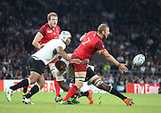 England's Captain Chris Robshaw with a quick offload to keep England attacking during the Rugby World Cup Pool A match between England and Fiji at Twickenham, Richmond, United Kingdom on 18 September 2015. Photo by Matthew Redman.