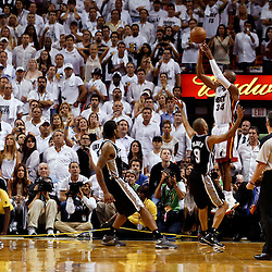 Jun 18, 2013; Miami, FL, USA; Miami Heat shooting guard Ray Allen (34) hits a 3-point, game tying shot with 5.2 seconds left in the fourth quarter of game six in the 2013 NBA Finals against the San Antonio Spurs at American Airlines Arena.  Mandatory Credit: Derick E. Hingle-USA TODAY Sports