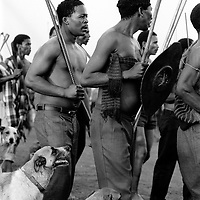 ANC supporting Xhosa warriors prepare to receive traditional magic potion for war, Mandela Park, Bekkersdal, 1993. (Photo by Greg Marinovich)