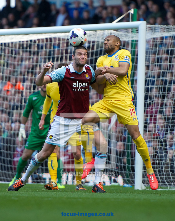 Andy Carroll of West Ham United battlees for the header with Danny Gabbidon of Crystal Palace during the Barclays Premier League match at the Boleyn Ground, London<br /> Picture by Alan Stanford/Focus Images Ltd +44 7915 056117<br /> 19/04/2014